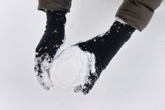Snowball in woman hands Stock Photo