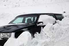 Snowbank stops car Stock Photo