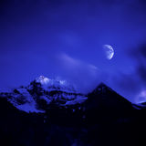 Snowberg Xiannairi с лунным светом Стоковая Фотография RF