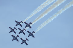 Snowbird Dive. Canadian Snowbirds in formation taking a dive Royalty Free Stock Photography