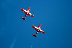 Snowbird Stunt Planes. Stunt plane doing a manuver against a bright blue sky Stock Photos