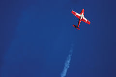 Snowbird Stunt Planes. Stunt plane doing a manuver against a bright blue sky Royalty Free Stock Photo