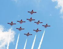 Snowbirds. Canadian Forces 431 Air Demonstration Squadron flying in formation against a blue cloudy sky Royalty Free Stock Image