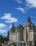 Snowbirds Over Chateau Laurier. OTTAWA, CANADA – JULY 1: The Snowbirds fly over the Chateau Laurier hotel during Canada Day on July 1, 2011 in downtown Ottawa Stock Photo
