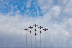 Snowbirds synchronized acrobatic planes performing at air show royalty free stock photo