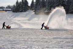 Snowblower. At work in a bavarian ski resort Stock Photos