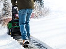 Snowblower in action being pushed after snowfall on a cold winter day in rural NJ, USA stock photography