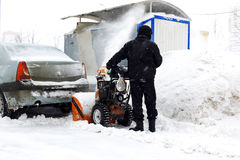 Snowblower in city Royalty Free Stock Photos