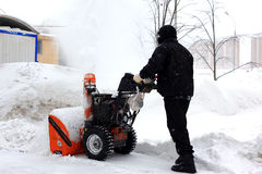 Snowblower in city Royalty Free Stock Image