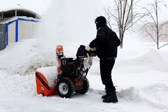 Snowblower in city. Under snowfall Royalty Free Stock Photo