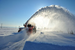 Snowblower cleaning road. Snowplow  removing snow for cleaning road Stock Photos