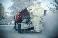 Snowblower clearing snow road Stock Photo