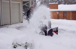 Snowblower Man Blurred by Snow royalty free stock photo