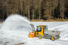 Snowblower,. Pickup truck with snowblower removing snow by  road Royalty Free Stock Photos
