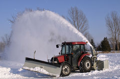 Snowblower. Tractor snowblower after a snowstorm Royalty Free Stock Image