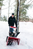 Snowblowing after a winter storm Royalty Free Stock Photo