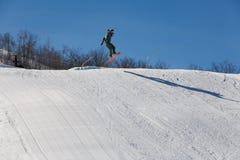 Snowboad jump Royalty Free Stock Image