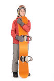 Snowboard. Woman in winter clothing holding a snowboard royalty free stock images