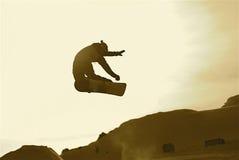 Snowboard. Er jumping methood on winter sunset Royalty Free Stock Photo