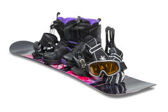 Snowboard with boot, gloves and goggles Royalty Free Stock Photo