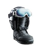 Snowboard boot with helmet and goggles Royalty Free Stock Photo