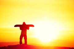 Snowboard concept sunset snowboarder copyspace ski royalty free stock photos