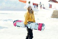 Snowboard de la muchacha. Imagen de archivo libre de regalías