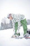 Snowboard de robe de fille photographie stock libre de droits