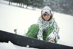 Snowboard de robe de fille photo libre de droits