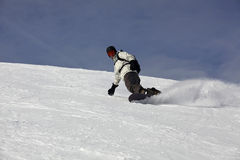 Snowboard Drift On A Snowy Blue Background Royalty Free Stock Image