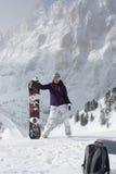 Snowboard dziewczyna Młoda kobieta stojak z jej snowboard Obraz Royalty Free