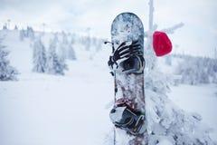 Snowboard equipment on ski slope Stock Photos