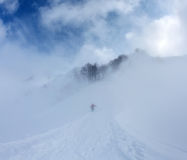 Snowboard in the fog on mountain slope Royalty Free Stock Photo