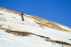 Snowboard freeride on the slope mountain Cheget. Royalty Free Stock Photography