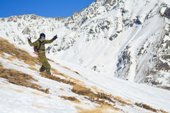 Snowboard freeride on the slope mountain Cheget. Royalty Free Stock Images