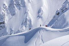 Snowboard freeride, snowboarders and tracks on a mountain slope. Extreme sport. Stock Photo