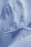 Snowboard freeride, snowboarders and tracks on a mountain slope. Extreme sport. Stock Image