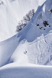 Snowboard freeride, snowboarders and tracks on a mountain slope. Extreme sport. Royalty Free Stock Image