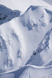 Snowboard freeride, snowboarders and tracks on a mountain slope. Extreme sport. Stock Photography