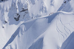 Snowboard freeride, snowboarders and tracks on a mountain slope. Extreme winter sport. Stock Images