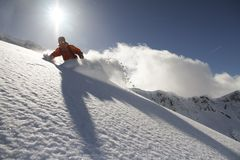 Snowboard freerider. In the mountains stock image