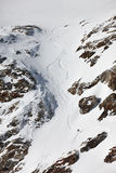 Snowboard freeriding in Alps. Snowboard freeriding between the rocks in Alps. Extreme winter sports Stock Photos