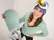 Snowboard and Fun Loving Female in Teal Royalty Free Stock Images