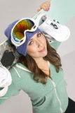 Snowboard and Fun Loving Female in Teal Stock Photography