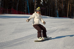 Snowboard Girl. On the slope in winter royalty free stock images
