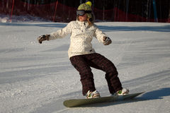 Snowboard girl. On the slope in winter stock images