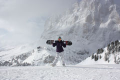 Snowboard girl. Young woman take her snowboard. Royalty Free Stock Photography