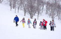 Snowboard - group training. NISEKO, JAPAN – FEBRUARY 7: Students walking for a ski training class on 7 February in Niseko. Niseko is the most famous city for Stock Photography