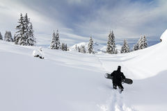 Snowboard hiking Royalty Free Stock Photography