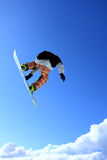 Snowboard jump. Young skier who jump high up in the air Royalty Free Stock Image